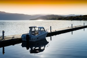 Horizontal sunset Norway boat near pier landscape background
