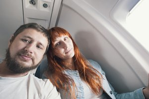 Portrait of a man couple - man and woman in the seat of aircraft