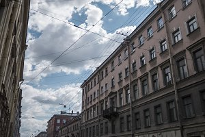 Petersburg houses connected by a web of high-voltage wires.