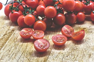Cherry tomatoes on cutting board.