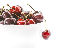 Healthy Cherries in white bowl.