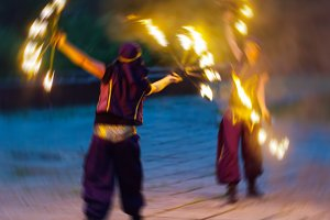 Horizontal vivid two female fakir playing with fire motion abstr