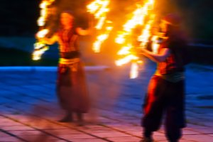 Square vivid two female fakir playing with fire blurred motion a