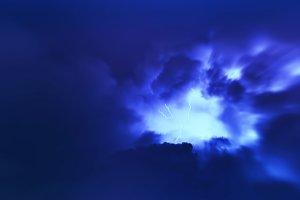 Horizontal vivid vibrant blue lightning storm cloudscape backgro