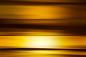 Vertical golden motion blur abstraction backdrop