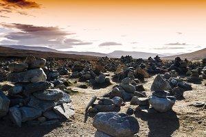 Horizontal vivid sunset Norway polar stones field landscape back