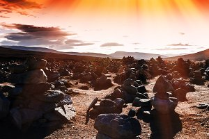 Horizontal vivid sunset Norway stones field with light leaks bac