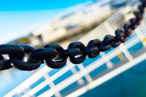 Horizontal vivid metal chain blue sky ladder composition backgro