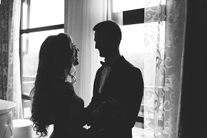 Moment of first meeting of groom and bride on their wedding day. Black and white photo