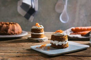 Mini carrot cake, stuffed with cream cheese, on blue concrete dish