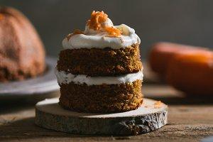 Mini carrot cake, stuffed with cream cheese, on rustic wood plate