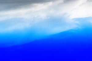 Horizontal wide dramatic cloudscape background backdrop