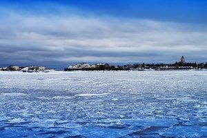 Vertical vivid ice on Finland lake landscape background backdrop