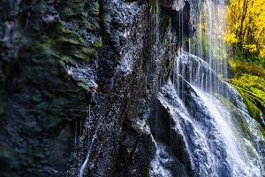 Horizontal vibrant waterfall bokeh background backdrop