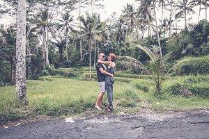 Romantic honeymoon couple dancing and having fun in the tropical jungle of Bali island, Indonesia.