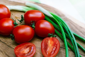 red tomatoes and green onions