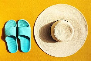 Beach accessories on yellow lounger