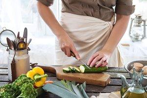 Woman slice vegetables