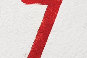 number Seven on old painted wall