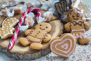 Sweet gifts for holiydays. Homemade christmas gingerbread cookies and caramel candies on board, horizontal