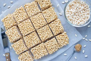 Homemade three ingredients bars with crispy rice, honey and peanut butter, horizontal, top view