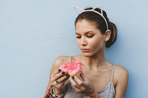 Woman holding tasty donut
