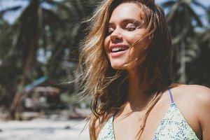 Pretty happy woman enjoying summer outdoors