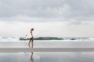 Girl in bikini with surfboard