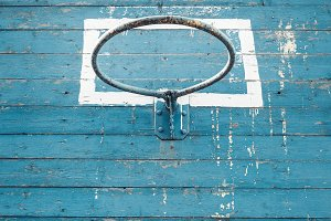 Old Hoop Basketball On Blue Wooden Background