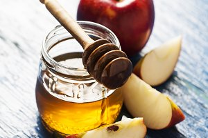 Rosh hashanah (jewish holiday) concept: honey and apple