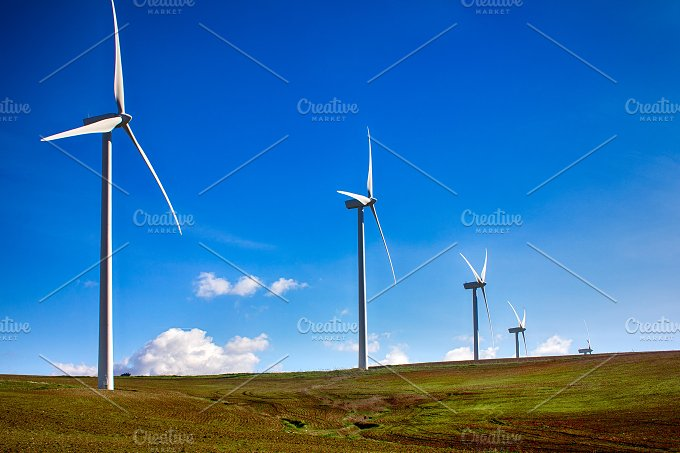 Windmills on green meadow. Spain - Technology