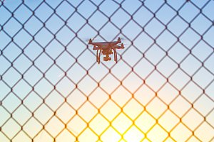 Drone flying over fence