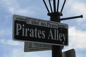 Pirates Alley New Orleans sign