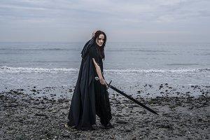 Female fantasy warrior on beach
