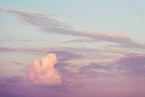 Sunset sky with beautiful clouds. Pastel colors.