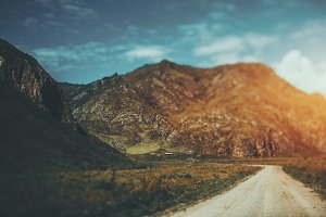 Tilt-shift view of road and mountain