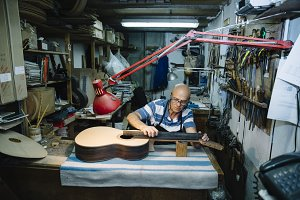Man working at a Workshop music