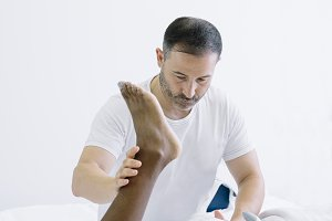 The physiotherapist treating a man