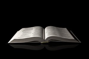 Bible isolated on black background