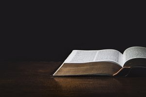Isolated Holy Bible in a dark