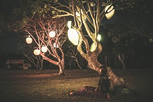 Woman and hanging lanterns on a light festival on Bali island, Indonesia.