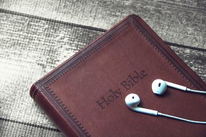 Holy Bible with headphones