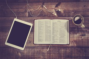 Bible with tablet and coffee