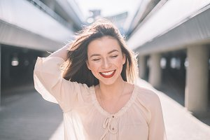 Smiling woman with red lips