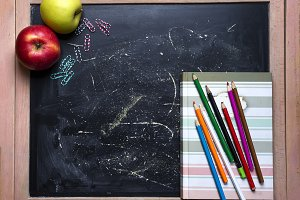 Apple and chalkboard.