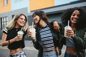 Female friends with ice coffee