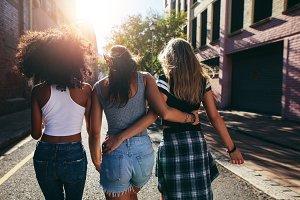 Three young women walking