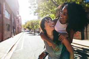 Two young woman having fun