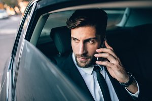 Businessman travelling by taxi