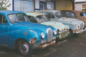 Old Rusted Cars in front of Garage
